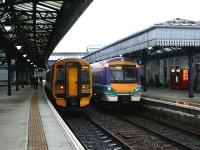 Local trains pass in Stirling station. On the left 158705 from Edinburgh to Dunblane while 170422 is on a Dunblane to Glasgow service. <br><br>[Brian Forbes&nbsp;27/12/2007]
