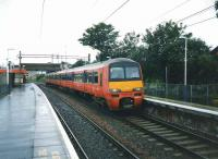 320 322 with an Aidrie service at Easterhouse in July 1997. <br><br>[David Panton&nbsp;/07/1997]