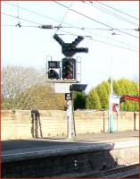 Interesting looking signal with various supplementary attachments standing on the northbound platform at Morpeth station on 8 November 2007. The white printed sign reads <I>Electric trains No access to South East Curve</I>.<br><br>[John Furnevel&nbsp;08/11/2007]