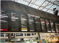 The late, lamented (by me at any rate) and colourful Solari departure board at Waverley west end in July 1997. Taking their name from the Italian manufacturer <I>Solari di Udine</I> and known in some quarters as the onomatopoeic <I>flapper - boards</I> these have now sadly been forced to give way to the more reliable and flexible (and silent) LED boards and/or LCD displays.<br><br>[David Panton&nbsp;/07/1997]