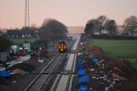 Sprinter heads into the sunset at Eastriggs. New line to right and MOD depot to left.<br><br>[Ewan Crawford&nbsp;03/01/2008]