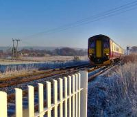 A Carlisle - Glasgow Central train heads for Dumfries along the G&SW route just west of Racks on a bright and frosty 17 December.  <br><br>[Brian Smith&nbsp;17/12/2006]