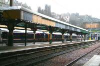 The partially refurbished canopy over the west end of platforms 18 and 19 at Waverley standing in the rain on 8 January 2008 and showing some of the work carried out to date. In the centre background the Church of Scotland General Assembly building overlooks the scene from the top of The Mound. <br><br>[John Furnevel&nbsp;08/01/2008]