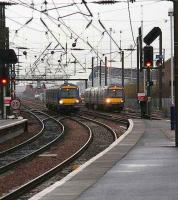 Trains for Waverley on the Glasgow and Forth Bridge lines run in parallel under the spaghetti approaching Haymarket just prior to the snow shower on 8 January.  <br><br>[John Furnevel&nbsp;08/01/2008]