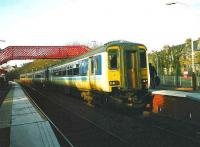 A 4-car 156 set for East Kilbride halted at Giffnock on 1 March 1999.<br><br>[David Panton&nbsp;01/03/1999]