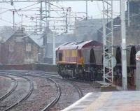 66234 passing through Paisley Gilmour Street in the rain heading for Longannet PS <br><br>[Graham Morgan&nbsp;14/01/2008]