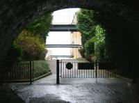 Arriving at the north portal of St Leonards tunnel (320m) on 2 January 2008, just short of the site of the former Edinburgh & Dalkeith Railway terminus at St Leonards. The majority of the site is now occupied by houses and flats, although one notable restored goods shed remains. Running above the tunnel mouth is Holyrood Park Road and directly ahead is now East Parkside. [See image 40388]<br><br>[John Furnevel&nbsp;02/01/2008]