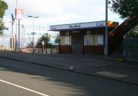 Entrance to Woodhall station on the east side of Port Glasgow. View northwest across Glasgow Road (and the Clyde beyond) on Sunday 29 July 2007. <br><br>[John Furnevel&nbsp;29/07/2007]