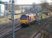 67001 turns south at Portobello Junction on 14 December and heads for Millerhill yard. The road bridge/embankment in the background follows the route that once carried the Lothian Lines spanning the <I>sub</I> and the ECML, on their way to Leith docks.  <br><br>[John Furnevel&nbsp;14/12/2007]