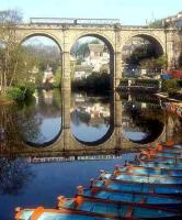 Knaresborough Viaduct in North Yorkshire, seen with a DMU crossing in 1979. The 1851 structure, with a total span of 338 feet, carries rail traffic 90 feet above the Nidd Gorge on the line between York and Leeds via Harrogate. <br><br>[Ian Dinmore&nbsp;//1979]