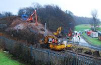 Overview of operations west of the Dalreoch tunnels. Three earthmoving cranes preparing the embankment, rail mounted crane, site office, generators and a myriad of trucks and vans (mostly out of shot).<br><br>[Ewan Crawford&nbsp;18/01/2007]