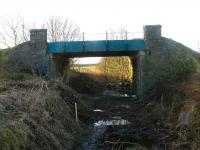 A last look at the A950 road over-bridge at Brucklay before demolition, looking south from the former station towards Maud Junction. Until recently this bridge was almost totally obscured at ground level by trees and vegetation.<br><br>[John Williamson&nbsp;19/01/2008]