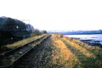 View looking west from Challenger Lodge along the embankment running between Lower Granton Road and the Firth of Forth towards Granton Harbour in November 1985 with track still in place.<br><br>[David Panton&nbsp;/11/1985]