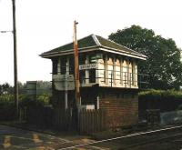 The old signal box standing at Greenfoot level crossing near Glenboig, photographed in September 1998. The box was demolished just over six months later.<br><br>[David Panton&nbsp;/09/1998]