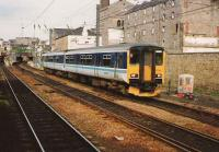 150 258 leaves Haymarket station for Bathgate in June 1994. Photographed from a passing train.<br><br>[David Panton&nbsp;/06/1994]