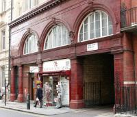 The former Piccadilly Line tube station in Down Street, Mayfair, seen here on 21 July 2005, some 73 years after closure. Opened in 1907 the station suffered due to the proximity of Hyde Park Corner and Green Park stations and closed in 1932. Down Street's claim to fame was in hosting several meetings of Churchill's war cabinet during WW2.<br><br>[John Furnevel&nbsp;21/07/2005]