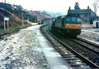A regular Saturday morning Waverley line working in December 1968  passes north through Gorebridge station as the Hawick pilot (a Clayton) is towed back to Millerhill Yard. On occasions the Galashiels shunter also formed part of the train. [See image 28123]   <br><br>[Bruce McCartney&nbsp;/12/1968]