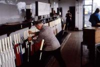 A signalman hard at work in the long departed Buckingham Junction signal box, to the west of the current Dundee station. (Photograph taken in 1980 during an Aberdeen University Railway Society trip to Dundee MPD).<br><br> (Update - The grey jacketed signalman is Mr Charles Dand.)<br><br>[John Williamson&nbsp;//1980]