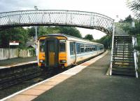 Glasgow Central - Edinburgh service at Hartwood in July 1998 formed by DMU 156 432. <br><br>[David Panton&nbsp;/07/1998]