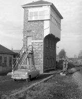 The signal box at Hardengreen Junction, looking north along the Waverley line towards Eskbank in December 1968. To the left is the trackbed of the Peebles loop. A locomotive shed was also located here (sub of 64A St Margarets), primarily to accomodate banking locomotives providing assistance on the climb south to Falahill. Eskbank station is on the other side of the bridge in the background. [See image 45679]   <br><br>[Robin Barbour Collection (Courtesy Bruce McCartney)&nbsp;22/12/1968]