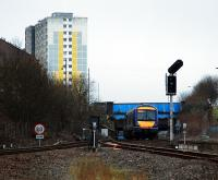 Queen Street bound at Cowlairs South Junction. Is that the gable end (left) which once bore a mural?<br><br>[Ewan Crawford&nbsp;02/02/2008]