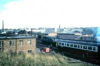 View east towards Haymarket station in September 1986 from the former Caledonian Railway overbridge carrying the Granton and Leith line running south from Murrayfield station. An Edinburgh bound class 27 on the line from Fife takes its train past a DMU manoevering in the sidings just to the east of Haymarket depot.<br><br>[David Panton&nbsp;/09/1986]