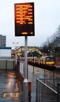 <i>Swish new</i> destination board at Dalmuir. A pity the same cannot be said for the passenger and staff accommodation at this busy junction station. Yoker route train in the platform.<br><br>[Ewan Crawford&nbsp;02/02/2008]