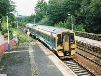 Aberdeen bound service formed by 158 701 at Huntly in June 1999.<br><br>[David Panton&nbsp;/06/1999]