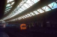 A DMU for Newcastle Central stands under the overall roof of the 1879 station at South Shields in the 1970s. As with a number of previous stations serving the town (the first being the Stanhope & Tyne in 1835) this one is no more. Today South Shields is served by a modern Tyne & Wear Metro station located a short distance to the west of this spot and opened in March 1984.<br><br>[Ian Dinmore&nbsp;//]