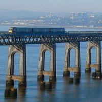 This Edinburgh 170 is passing the locus of the former distant semaphore signal for Tay Bridge South Junction. Ninewells Hospital and the three blocks of high flats at Blackness are visible on the north shore beyond the train.<br><br>[Brian Forbes&nbsp;12/01/2008]
