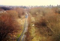 This was the view looking east over the disused Glasgow Central Railway platforms at Carmyle station in 1988. The platforms are now buried under the embankment of the M74 extension into Glasgow. The Rutherglen and Coatbridge platforms were further to the right. Today that is the location of the new(ish) station.<br><br>[Ewan Crawford&nbsp;//1988]