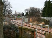 View east beyond the buffer stops at Alloa station on 14 February as the line crosses the bridge over the B9096 road and heads for Longannet. <br><br>[John Furnevel&nbsp;14/02/2008]