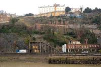 View across the Avon from the Portishead branch on 15 February towards the lower entrance to the Clifton Rocks Railway, a funicular built within the cliff face of the Avon Gorge. Closed since 1934, the Clifton Rocks Railway Trust has been formed with the objective of restoring this unique structure.<br><br>[Peter Todd&nbsp;15/02/2008]