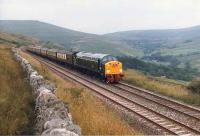 D200/40122 approaching Dent station on the Settle and Carlisle line on 31 July 1983 with the Kings Cross - Warcop <I>Hadrian Pullman</I>. <br><br>[Colin Alexander 31/07/1983]