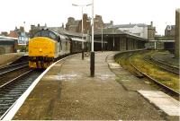 A 37 takes the Royal Scotsman north, at speed, through the curve of Arbroath station. The platform to the right was for locals to Forfar.<br><br>[Ewan Crawford&nbsp;//1989]