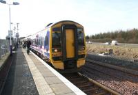 The 14.33 train to Edinburgh Waverley boards at Uphall on 15 February. Note the earth moving equipment at work on new access facilities on the the north side of the line in connection with the doubling of the route.   <br><br>[John Furnevel&nbsp;15/02/2008]