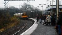 A Glasgow bound service enters Alexandria and a number of passengers walk purposefully along the platform on New Years Eve 2007. A short portion of the old disused northbound platform remains on the bridge.<br><br>[Ewan Crawford&nbsp;31/12/2007]