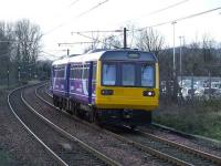 Northern pacer 142014, photographed approaching Johnstone on 27 February, on its way to Glasgow Works for overhaul. The 142 units use the G&SW route as they are banned from using part of the West Coast Main Line<br><br>[Graham Morgan&nbsp;27/02/2008]