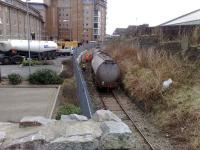 EWS staff at the scene of a tanker derailment on the Aberdeen Waterloo branch on 28 February 2008. Photograph shows the contents of one of the tanks in the process of being transferrred to a nearby ASCO road vehicle.  <br><br>[Stan Scott&nbsp;28/02/2008]