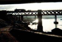 40192, with its boiler water tanks removed, is silhouetted crossing the King Edward Bridge in November 1980. Photographed looking west along the Gateshead bank of the Tyne with Redheugh Bridge visible in the background.<br><br>[Colin Alexander&nbsp;01/11/1980]