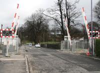 Looking north towards the A907 past the newly installed automatic barriers at Cambus level crossing on 28 February 2008.<br><br>[John Furnevel&nbsp;28/02/2008]