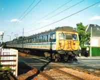 305 506 with the daily North Berwick - Kirknewton service on Kingsknowe level crossing in July 1999. <br><br>[David Panton&nbsp;/07/1999]
