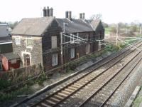 Barton and Broughton station closed in 1939 but the station building survived as a pair of houses next to the down WCML until finally demolished in the summer of 2013. Pictured from the overbridge looking north in March 2008. [See image 44079] (SD 515364)<br><br>[Mark Bartlett&nbsp;01/03/2008]