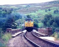 Northbound train crossing the Oykel Viaduct over the Kyle of Sutherland in 1977 on the approach to Invershin station.<br><br>[Ian Dinmore&nbsp;//1977]