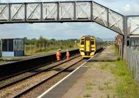 First station after leaving the Severn Tunnel on the Cardiff - Bristol route is Pilning, seen here with a PW squad giving way to a 158 on 17 August 2007.<br><br>[Peter Todd&nbsp;17/08/2007]