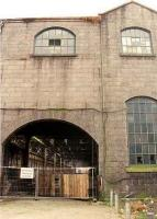 View south of the imposing exterior of Aberdeen Guild St goods shed, built on the site of Guild St passenger station, which was replaced by the present station. The shed was demolished and the yard cleared for the Union Square development.<br><br>[Ewan Crawford /08/1999]