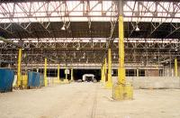 Interior of Guild Street Goods shed, east side, at the time given over for use as a carpark with a small portion at the south still in use for dry goods. This massive building has since been demolished. View looks north.<br><br>[Ewan Crawford /08/1999]