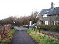 This station on the Lancaster to Glasson Dock branch closed in 1930 although goods trains passed through until 1964. The line is now a cycle path along the River Lune. The station house is still in use and the level crossing gate posts are in situ but the station site is a picnic area and car park. View towards Lancaster.(SD 457561)<br><br>[Mark Bartlett 07/03/2008]