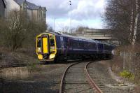 An Edinburgh bound 158 passes Inverkeithing South Junction on 4 March. Seen from the public foot crossing on the Rosyth/North Queensferry pier branch.<br><br>[Bill Roberton&nbsp;04/03/2008]