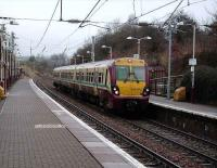 A train for Dalmuir via Motherwell formed by 334 013 stands at Airbles on 23 February.<br><br>[David Panton&nbsp;23/02/2008]